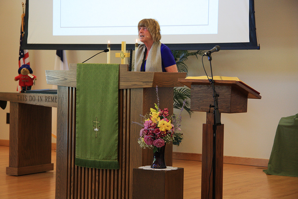 Pastor Janine speaking from the pulpit